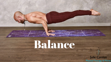 Man balancing in plank position on his hands with feet up